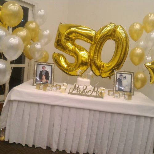 Decoración fiesta 50 años Dorada